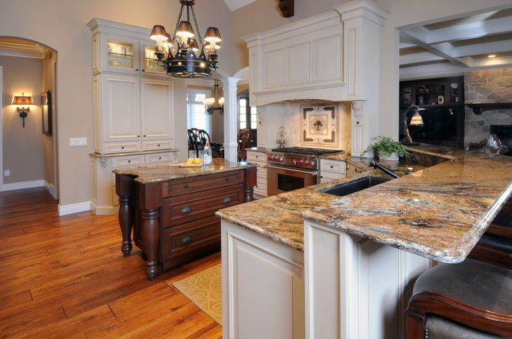 Vaulted Ceiling Kitchen Remodel with White Painted Cabinetry and Dark Kitchen Island Cabinetry - By Bella Domicile with Dura Supreme Cabinetry