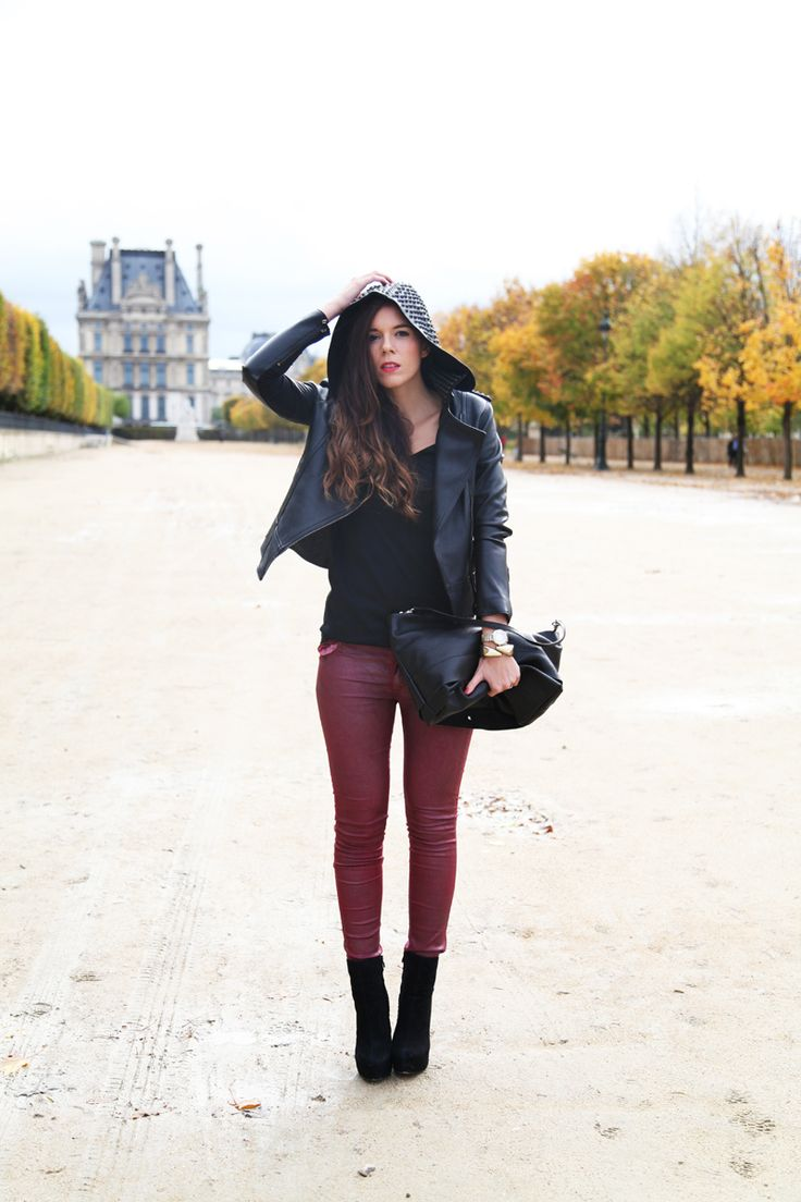 Black leather with burgundy jeans for a casual daytime look for strolling around Paris