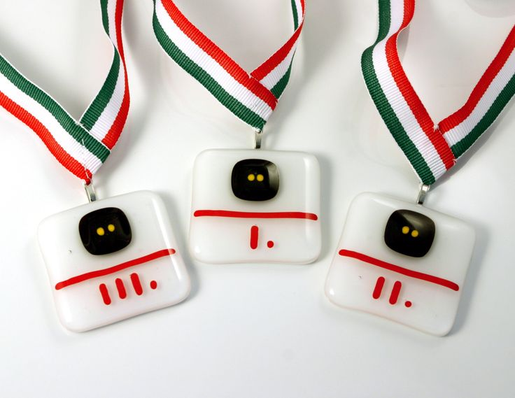 Squash medals made of fused glass. Watch the squash ball with two yellow dots ;)