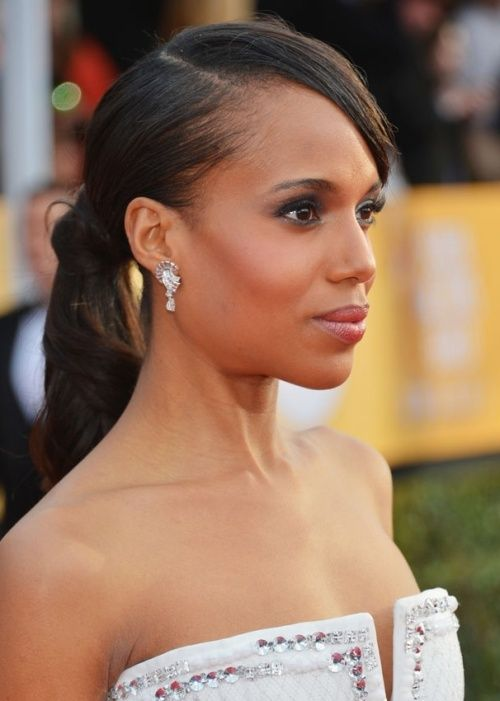 56. Kerry Washington African American Hairstyle: Pretty ponytail Kerry Washington shows us another hot hair trend for 2013/2014 – pretty, polished ponytails! She wears her mid-height ponytail with a deep-parted, side-swept fringe that neatly frames her face. To finish off your posh ponytail, wrap a strand of your hair around the hair-tie to conceal it.