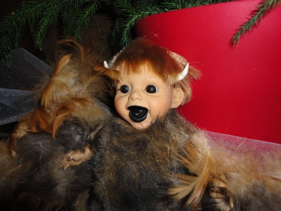 Meet Bubba sweet fun lovin demon art doll with real chicken feathers. $25.00, via Etsy.