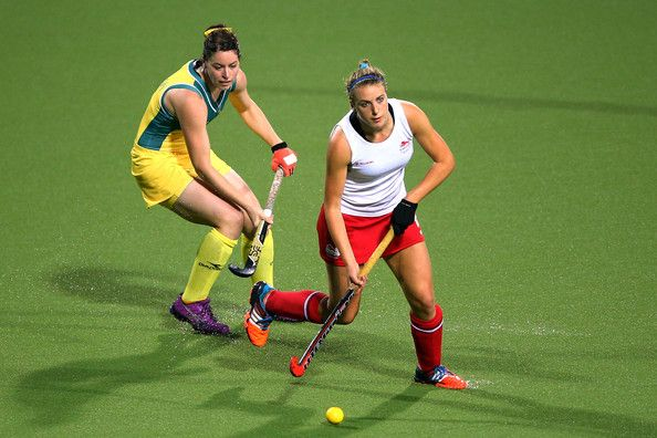 Lily Owsley Photos Photos - Lily Owsley of England goes past Karri McMahon of Australia in the Women's Gold Medal Match at Glasgow National Hockey Centre during day ten of the Glasgow 2014 Commonwealth Games on August 2, 2014 in Glasgow, Scotland. - 20th Commonwealth Games: Hockey