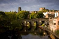 View of the city of Durham with the tops of the Norman Cathedral and Castle in the distance and the River Wear running through the centre of the city., Durham, County Durham, England.