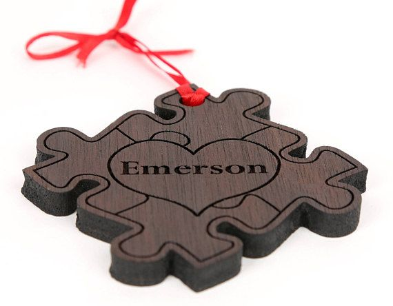 Personalized Puzzle ornament, autism awareness with name or saying in the heart.  We use solid natural wood, NO paint, NO stain, NO Plywood.  Perfect keepsake to add to your tree. Makes a great Babys First Christmas Gift.  Made in our home based workshop this ornament is laser engraved with your personal information and then sanded and finished with a red ribbon.  Measures approximately 3 x 3  Available in Pine Oak Maple Cherry Walnut Spalted Maple Yellow heart Padauk Please add the…