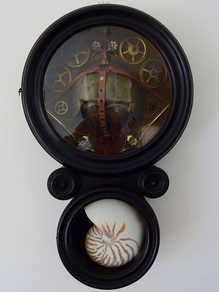 <The Ark of Atlantis>7/7/2015 by Masahide Kobayashi (小林正秀)  55 (H.) × 34 (w.) × 12 (D.) cm Mixed Media  ANSONIA Figure 8 Wall Mount Rosewood Clock Case, Upper Trunk : Atlantic Horseshoe Crab; Leather Strap with Brass Ring; Drawer Pull with Plate; Clock Gear, Lower Trunk : Nautilus Shell; Dried Flower with Fragrant Oil; Gold Leaf; Fankincense and Myrrh (Gum Resin and Essential Oil)