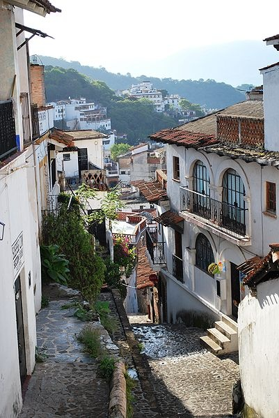 Taxco - Mexico  White stucco buildings, red tile roofs, cobblestone streets.  We awakened to the sounds of mariachi bands & church bells.