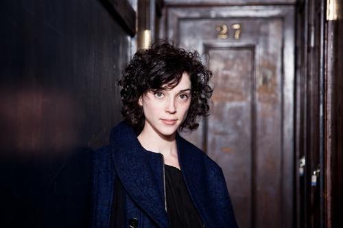 Annie Clark's beautiful curly hair.