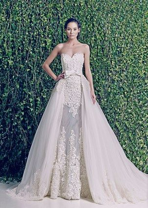 "ZUHAIR MURAD 2014 Fall/Winter Collection ""Martina"" is available at Chernaya Bridal House in the Miami Design District. Martina is a unique four piece gown featuring a fabulous sheath, and an incredible removable lace and sheer jacket with full sleeves, an organza and lace open skirt and a bow belt. Martina is a show-stopper. This picture shows the gown without the jacket. #zuhairmurad #zuhairmuradbridal #bridalluxury #chernayabridalhouse #thechernayaexperience #miamibridal"