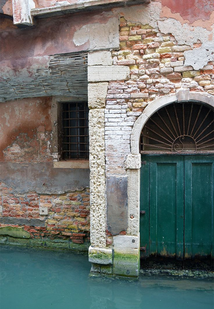 Photo diary of a solo trip to Venice, Italy, one of the most romantic cities in the world. image: building crumbling into a canal