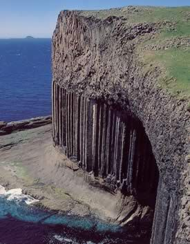 Fingal's Cave on Staffa - Its struture is unique. Nowhere else is there a sea-cave formed completely in hexagonally-jointed basalt. To this the size, the sounds, the colours, and the remarkable symmetry of this 227-foot cavern; and by Nature's gift of fractured columns forming a crude walkway just above high-water level, allowing exploring visitors to go far inside.