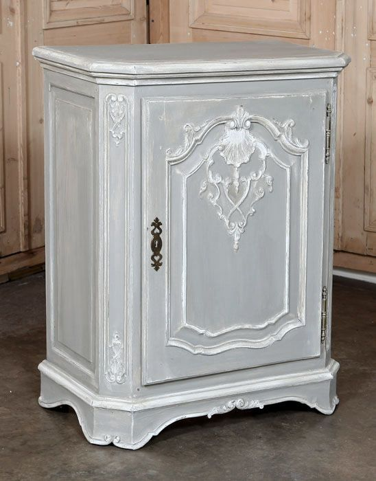 The ideal choice for a niche, space between two windows, or even the corner, this provincial confiturier, or one-door buffet, features tailored architecture and a modest amount of carved detail ideal for the Country French or casual interior. Door opens to reveal surprising storage inside! Lovely two-toned painted finish with its soft patina makes it visually striking.