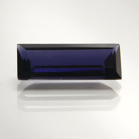 Natural Iolite 2.16 carats   Rectangular step cut   13.95mm x 5.24mm x 3.74mm   Slightly included   Collected in the 1980s The beautiful purple