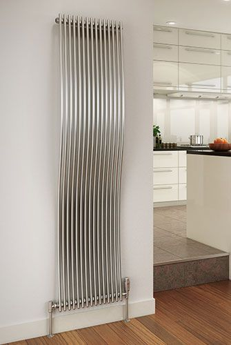 Slight wave design on this radiator make a change from the usual flat panels.