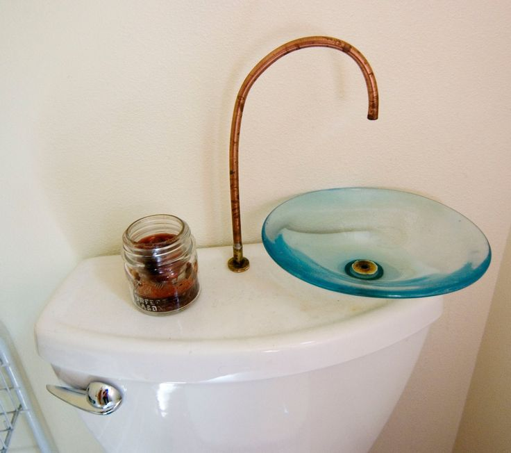 water and space-saving toilet/sink