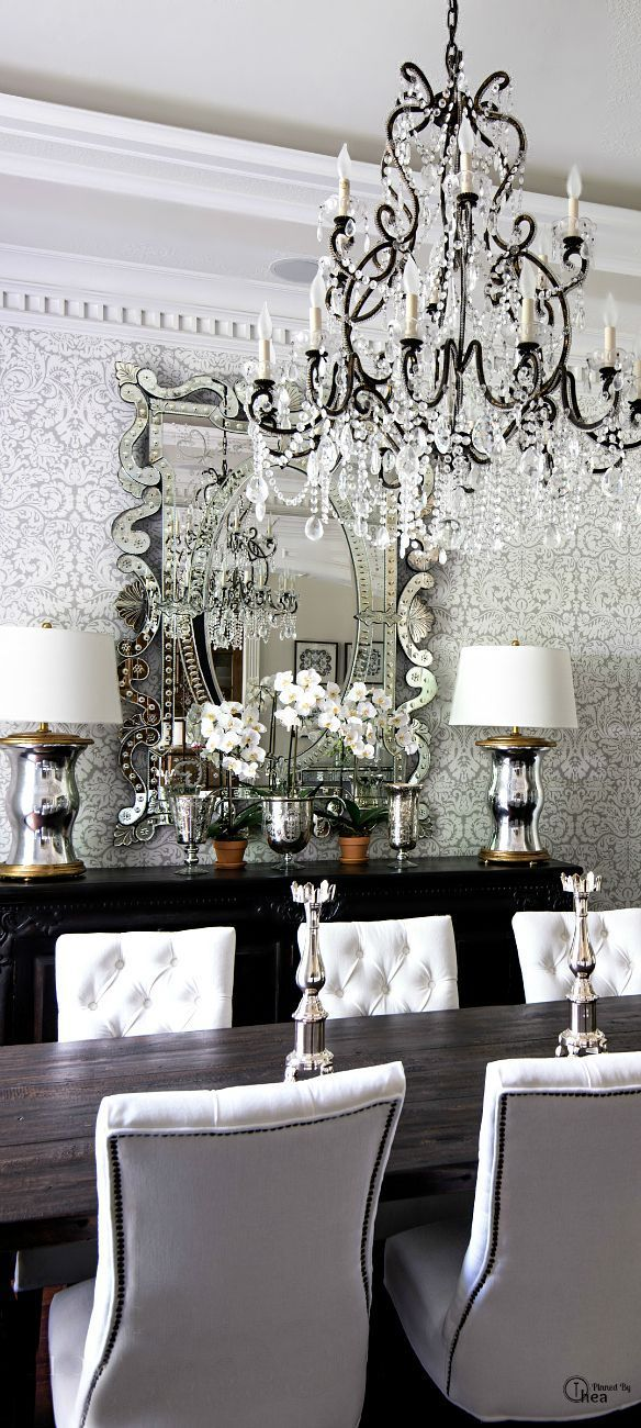 dining room chandelier, damask wallpaper, white tufted studded chairs, glam dining room