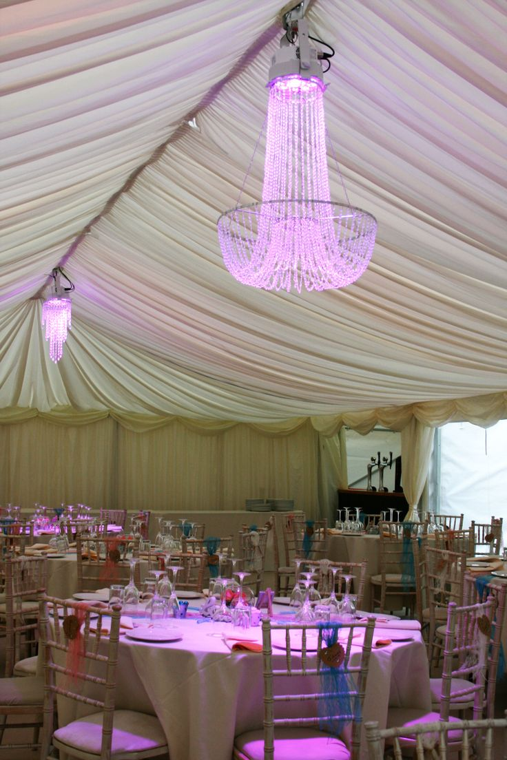 Crystal chandeliers with colour wash www.24carrotevents.co.uk