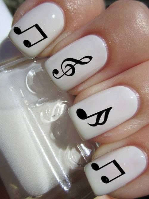 Maybe just one nail with a note and the others a solid color.... Would look cute.