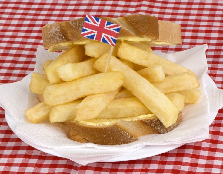 "A chip butty, is a sandwich made with bread or a bread roll (usually white and buttered) and hot chips, often with some sort of sauce such as tomato sauce (i.e. ketchup) or brown sauce. The word butty is a contraction of ""bread and butter"" that came from northern England."