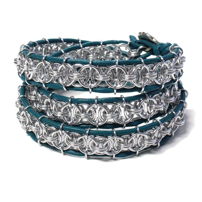 Triple Wrap-sody Chainmail Bracelet is based on the beaded leather wrap bracelet, a popular jewelry design worn by celebrities and showcased in beading and fashion magazines. This chainmail version features a helm chain weave, in place of beads, between 2mm turquoise leather cord edging. The bracelet is created with anodized aluminum jump rings, making it lightweight and tarnish-free, and finished with a decorative TierraCast pewter button.