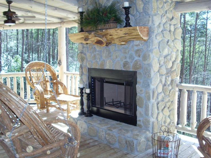 River stone, cedar mantel, exterior fireplace