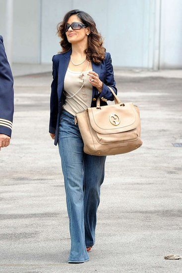 Salma Hayek wearing straight leg jeans... as a curvy hourglass know that.. skinny jeans is not the only option.. a style and cut like this can look equally fantastic!