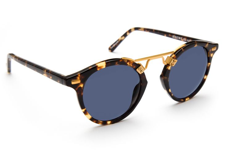 Architectural in design, St. Louis' bold metal bridge is inspired by the iconic cast-iron balconies found in the French Quarter, with a rounded silhouette that works well on most face shapes. Features a blue polarized lens and a handcrafted bengal tortoise acetate frame. Gigi Hadid, Kendall Jenner, Adriana Lima, Selena Gomez, Dakota Fanning, and Michiel Huisman all own a pair. Free shipping and lifetime warranty.