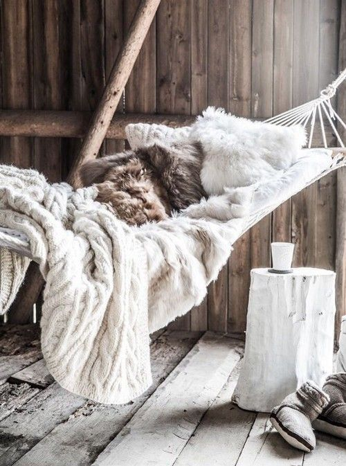 23 Interior Designs with Indoor Hammocks. Messagenote.com Fur throw and pillows  white colored side table stump  rustic floor
