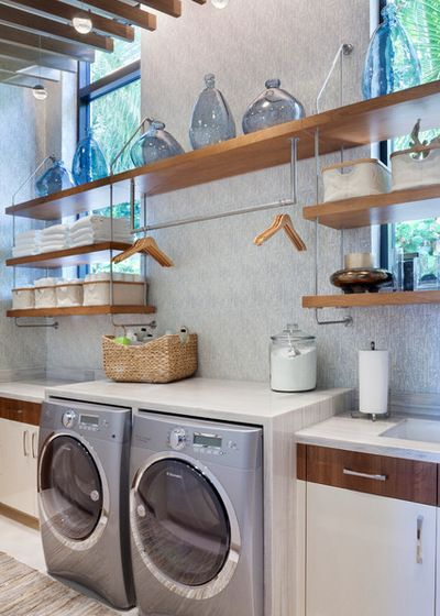 my idea of a great laundry area for basement. Contemporary Laundry Room by…