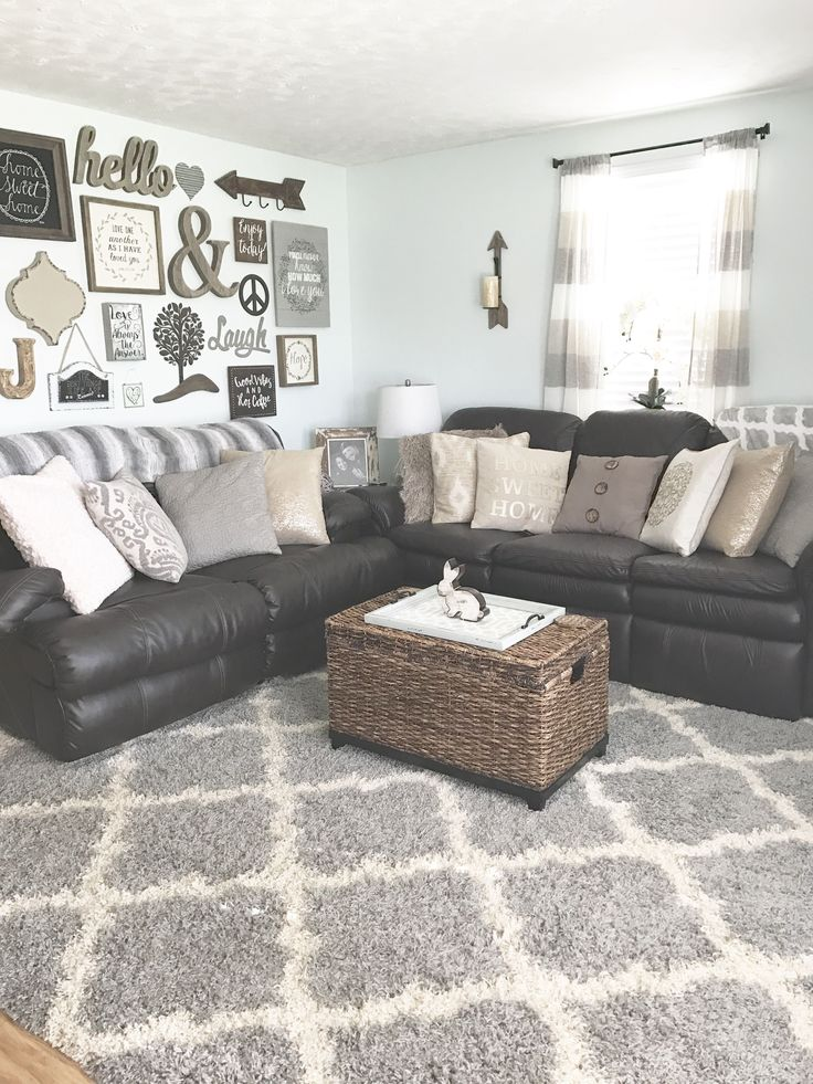Cozy, rustic, farmhouse, glam, chic, inspired living room in neutral colors, mostly greys, browns, beige, whites, & a splash of gold. My favorite, the gallery wall, cozy pillows, and leather couches make it a perfect southern family room! UPDATE! What I've added: the moroccan rug, and changed out the reindeer center piece for the rustic Easter bunny, just in time for Spring!