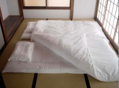 Futon Mattresses Spread Out On Tatami Flooring When You Wake The Matresses Are D In Surrounding Built Wardrobes