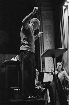 Igor Stravinsky conducts a rehearsal of Persephone in New York City. Ballerina and actress Vera Zorina (L), who acts as narrator, watches him, holding a score.