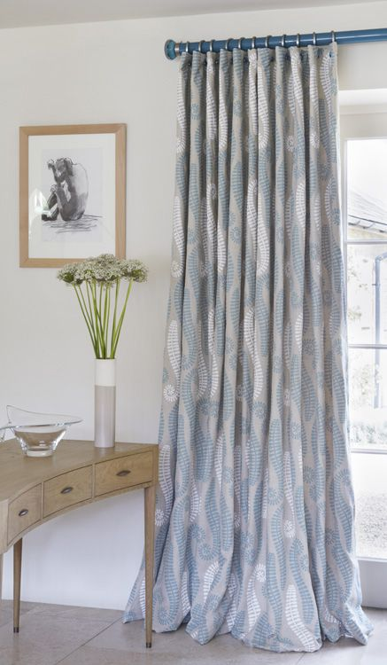 Teal lacquered pole adds a pop of colour to this fresh bright interior www.walcothouse.com