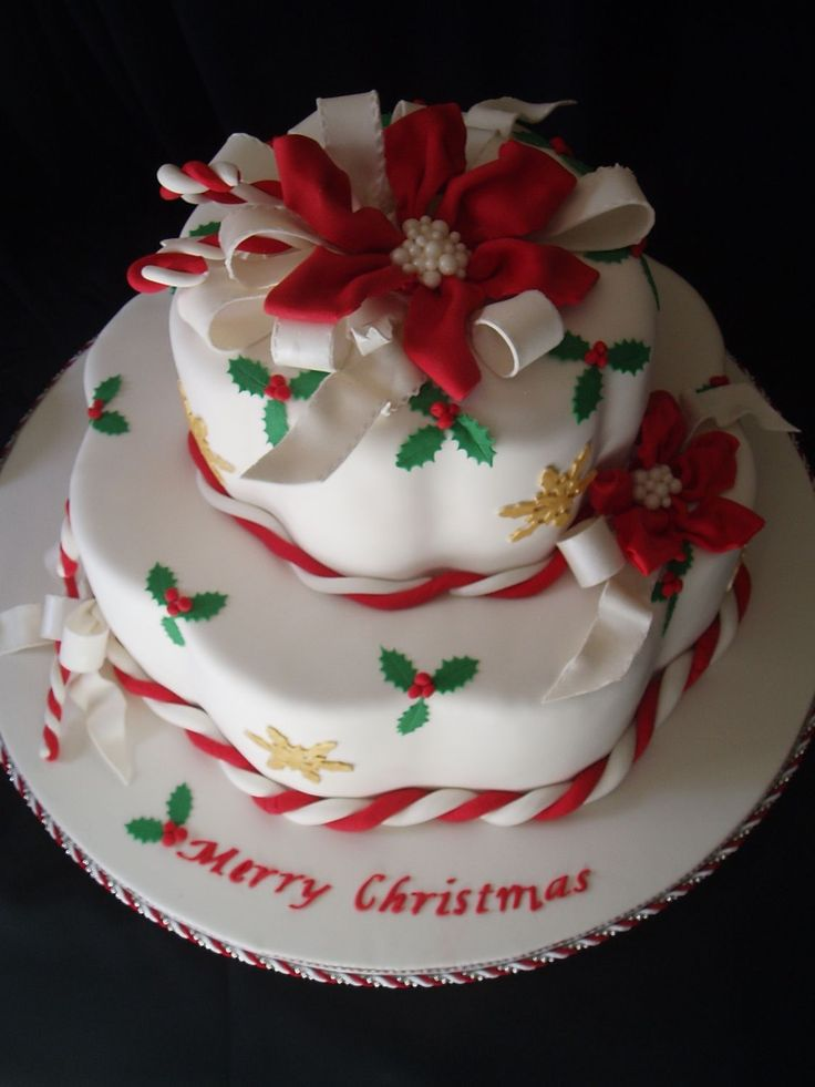 Candy Canes and Christmas - This was inspired by Colette Peters Christmas Cake pictured on the cover of American Cake Decorating Nov/Dec 1995 issue. This cake is the Wilton petal pan. The cakes rest on a fondant covered board and I used gumpaste poinsettie ribbon flowers with bow loops. Thanks for looking and Merry Christmas!