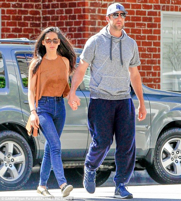 Happily together: Olivia Munn, 35, and boyfriend Aaron Rodgers, 32, were quite the lovin...