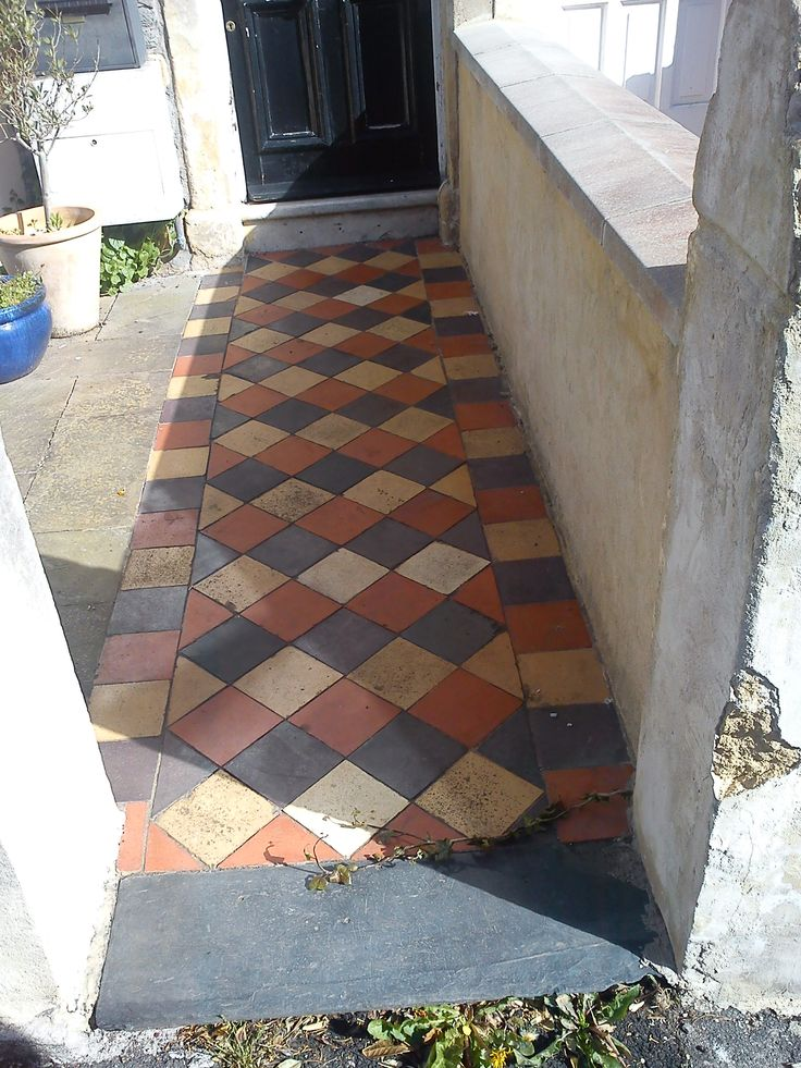 Original Victorian quarry tiles on our street, arranged in diamond pattern. Like the slate threshold. Note there is no raised side border.