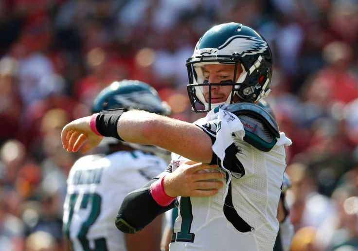 Eagles vs. Redskins:     October 16, 2016   -  27-20, Redskins  -     Philadelphia Eagles quarterback Carson Wentz tries to fix his jersey after it was torn in the first half of an NFL football game against the Washington Redskins, Sunday, Oct. 16, 2016, in Landover, Md.