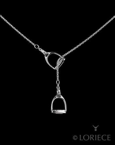 "English stirrup lariat. From farm to fashion, this equestrian lariat has exquisitely detailed stirrups including tread and buckle attaching to a reverse rope 24"" inch chain.  	925 Sterling Silver (nickel free, tarnish resistant) 	1/2"" wide; 1"" tall 	Longer chains available upon request 	Available in gold (call for pricing 586-850-5983"