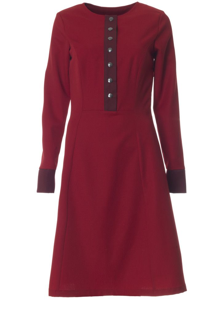 The Lizzi dress is a real 70ties inspired retro dress. It is made of red wool with Bordeaux details.