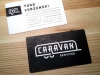 Caravan Services business card with wordmark, designed by Renee Fernandez, white lettering on black background. #logo #wordmark #caravan #design #typography   Great wordmark for this business! Minimal illustrative elements with geometric style letters get the message across. Great inspiration for designers.