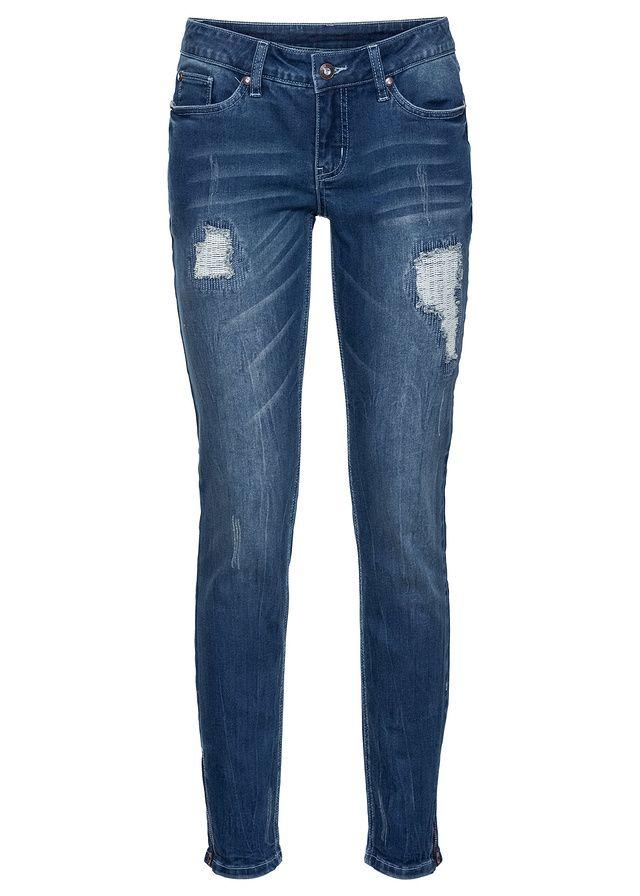 Dżinsy z kolekcji Bodyflirt zdobione wytarciami i przetarciami. Zwężane nogawki z zamkami po bokach. Świetne do czółenek lub botków i eleganckiej bluzki. Dł. w rozm. 38 ok. 78,5 cm.