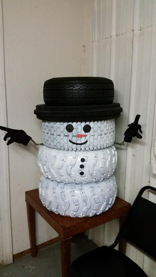 Our snowman that we made out of tires at the shop he 39 s for Tire decoration ideas