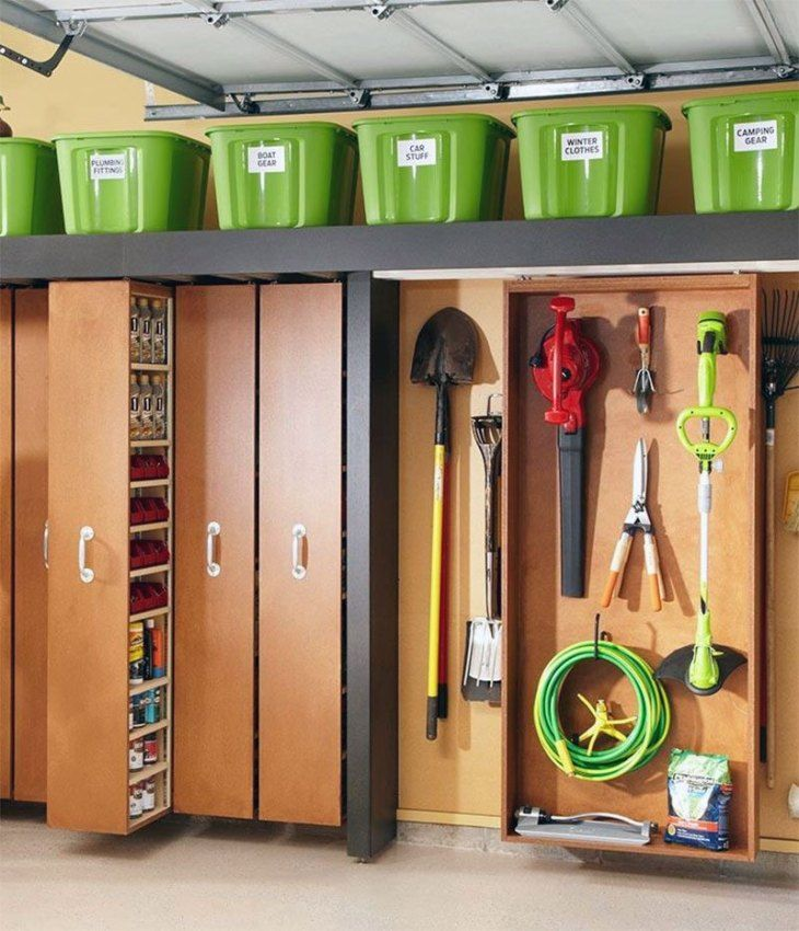 Sliding Space-Saving Shelf System | From our collection of 34 Amazing DIY Garage Organization Hacks