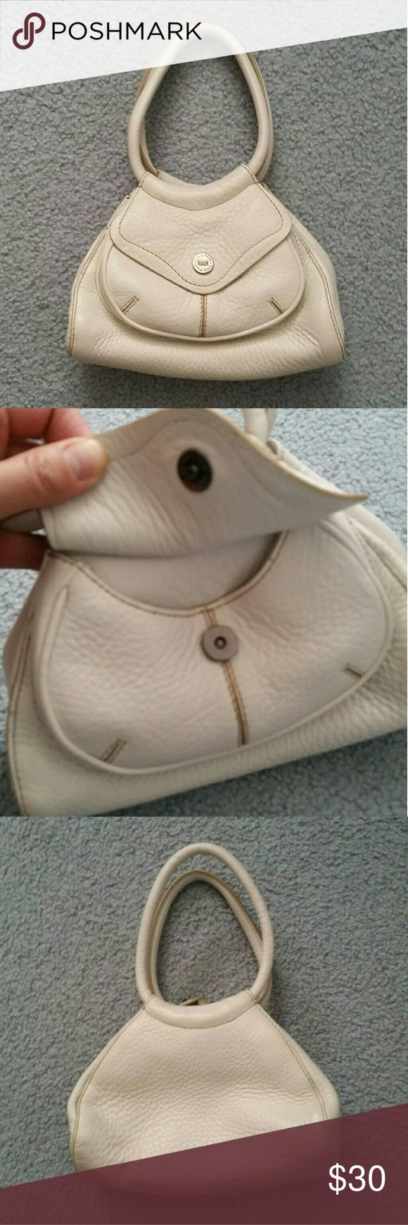 Cole Haan Mini Purse This is a off white pebbled leather purse from Cole Haan. It is very small and can only fit a couple things. It has two handles and a snap in the middle to hold the purse together. It has a small pocket in the front with a flap and a small zipper pocket inside the purse. This purse was only used once or twice and it in great condition. Cole Haan Bags Mini Bags