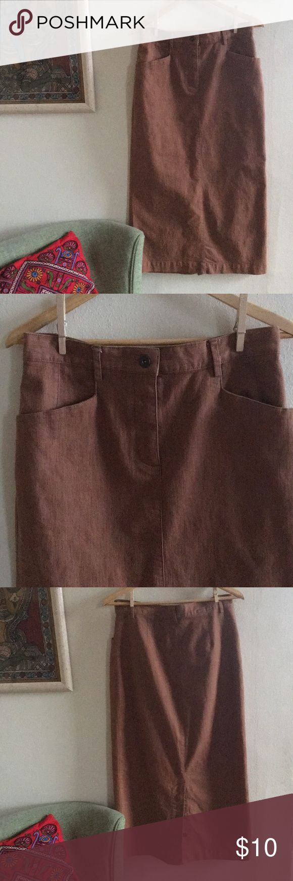 """Brown stretch denim skirt - buttons in the back Classic shape. Long denim skirt with stretch. Love the buttons on the back bottom. Perfect condition! Size 4. Waist measures 15"""" flat length is about 34"""" Christopher & Banks Skirts"""