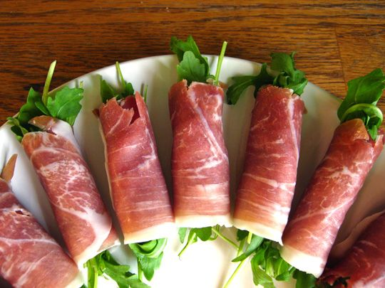 Prosciutto-wrapped Arugula. Add pear & cheese for oomph;)