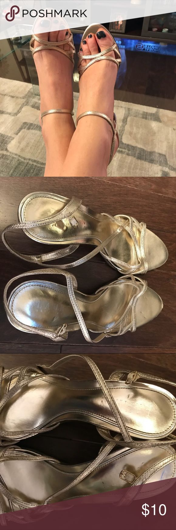 Ralph Lauren gold strappy sandals! In the third pic, you will see that the front of one of the shoes is scuffed! These sandals go with everything!!! I love them and they are super comfortable, but they have been worn! Ralph Lauren Shoes Sandals