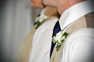 linen vest, navy tie,  spray rose & baby's breath bout.