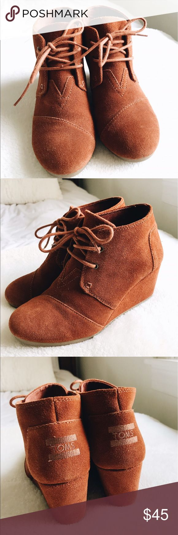 Tom's Burnt Orange Suede Desert Wedges These are a lightly worn pair of Tom's wedges/booties! Since they're Tom's, they're easily the most comfortable heels I've ever worn. These would be perfect for a fall outfit! Toms Shoes Wedges