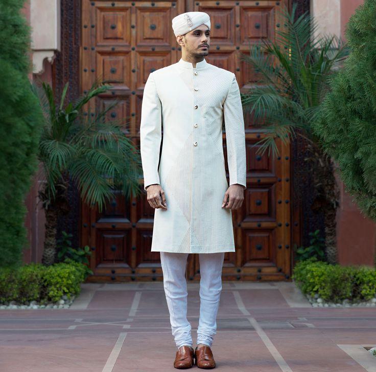 Ivory and Gold Embroidered Sherwani.  #sherwani #bandhgala #menswear #Couture #bridal #groom #weddingcollection #indianweddings #SSHOMME