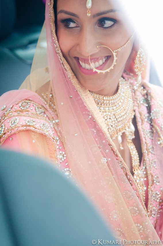Beautiful vintage Sikh bride in pink lehnga with pearl naath and pearl jewelry set | Beauty by Amplified Soul | Photography by Kumari Photo